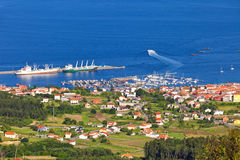 Fishing town and harbor in Arosa estuary Stock Photography