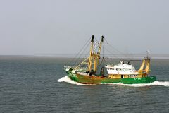Fishing trailer. Motoring over a calm sea Royalty Free Stock Photography