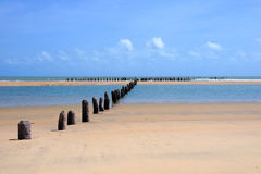 Fishing trap. Beach with old fishing trap installed Royalty Free Stock Photography