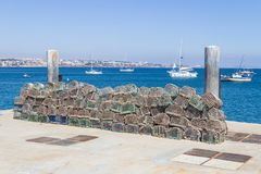 Fishing trap and Boats docked in a Marina in Cascais Royalty Free Stock Image