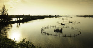 Hoi-an lakes,vietnam 8. A fishing trap on The lakes and inland waterways of hoi-an in vietnam at sunset Royalty Free Stock Photos