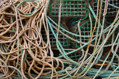 Fishing Traps. Stack of old and dirty fishing traps and a mess of ropes Stock Photo