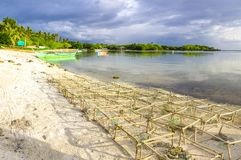 Fishing traps laid out on a beach. On Bantayan, Philippines Stock Photo