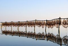 Fishing traps at sunset. Fishing traps against lovely reflection at sunset Royalty Free Stock Photography