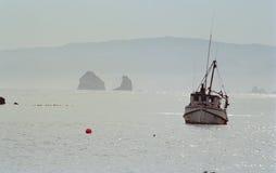 Fishing trawler. White fishing trawler anchored in the port Royalty Free Stock Photos