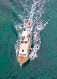 Fishing trawler aerial vertical view. Fishing trawler on blue sea aerial vertical view Royalty Free Stock Photography