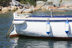 Fishing trawler anchoring in harbour Stock Photography