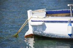 Fishing trawler anchoring at port Stock Images