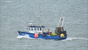 Fishing trawler boat. Hd video footage of a fishing trawler boat heading for harbour off the kent coast of whitstable taken 27th july 2017 stock video