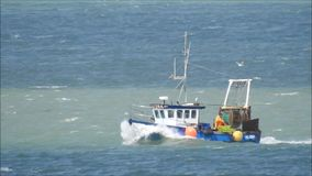 Fishing trawler boat. Hd video footage of a fishing trawler boat heading for harbour off the kent coast of whitstable taken 27th july 2017 stock footage