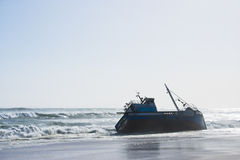 Fishing trawler grounded after heavy storm Stock Image