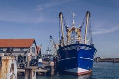 Fishing trawler moored near Restaurant De Kombuis. Texel, The Netherlands, October 13, 2018: fishing trawler moored near Restaurant De Kombuis at Oudeschild royalty free stock images