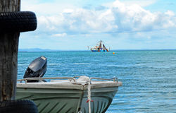 Fishing trawler & motor boat dinghy at sea Stock Photography