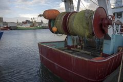A fishing trawler with fishing nets at the docks of the harbor of Ijmuiden royalty free stock images