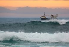 Fishing Trawler. Off the coast off South Africa at sunset Stock Images