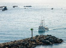 Fishing trawler Returns To Home Port royalty free stock photo