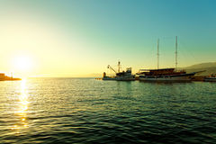 Fishing trawler and a sailboat moored in the harbor of a small town Postira - Croatia, island Brac Royalty Free Stock Photos