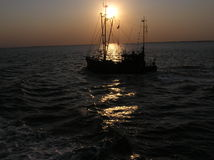 Fishing trawler on sea Stock Images