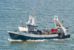 Fishing trawler at sea Stock Photo