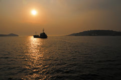 Fishing trawler at sea, sunset Royalty Free Stock Image