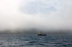 Fishing trawler during a storm in Pacific ocean Royalty Free Stock Photos