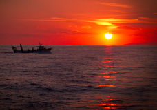 Fishing trawler. On the water at sunset Royalty Free Stock Photography
