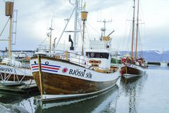 Fishing trawlers in Akureyri Harbour in Iceland royalty free stock photography