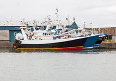 Fishing trawlers berthed at the quay. Royalty Free Stock Photos