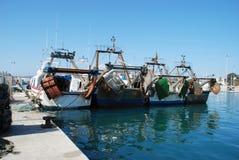 Fishing trawlers in Caleta de Velez harbour. Royalty Free Stock Photo