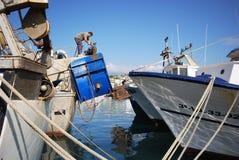 Fishing trawlers in Caleta de Velez harbour. Stock Photo