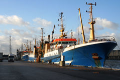 Fishing Trawlers in the Harbor Stock Photography