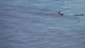 Fishing trawlers in open sea water with fishing nets in Taiwan. Aerial view stock video