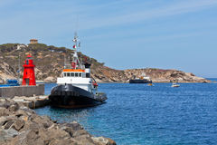 Fishing Trawlers and Small Red Lighthouse Stock Image