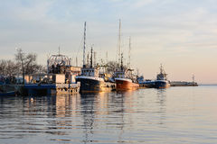Fishing trawlers at sunset. Nessebar, Bulgaria royalty free stock photos