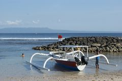 Fishing Trimaran in Bali, Indonesia. Small trimarans used as fishing boats in Indonesia. They come from the Province of Bali. The boats are all made from one stock photo