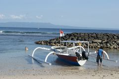 Fishing Trimaran in Bali, Indonesia. Small trimarans used as fishing boats in Indonesia. They come from the Province of Bali. The boats are all made from one royalty free stock photography