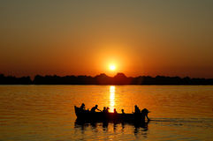 Fishing trip. Boat and sunset in Danube Delta, Romania Stock Photography