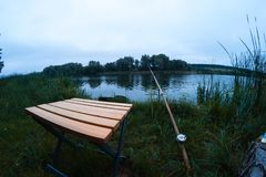 On a fishing trip in a cloudy summer day. Royalty Free Stock Image