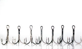 Fishing triple hooks. On a white background Stock Photos