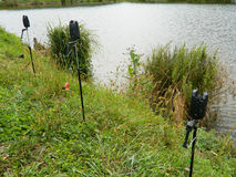 Fishing tripods. Modern fishing tripods, empty fixed near lake prepared to support fishing poles Stock Photo