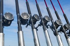 Free Fishing Trolling Boat Rods In Rod Holder. Big Game Fishing. Fishing Reels And Rods Pattern On Boat. Sea Fishing Rods And Reels In Royalty Free Stock Images - 188720619