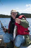 Fishing trout. Fisherman posing with rainbow trout royalty free stock images