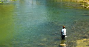Fishing for Trout on the Roanoke River. Roanoke County, Virginia USA - April 27th: A Fishman fishing for trout in the Roanoke River located in Roanoke County royalty free stock photo