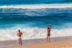Fishing Men Beach Surf Royalty Free Stock Photography