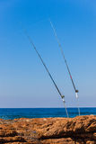 Fishing Rods Rocks Sea Stock Photo