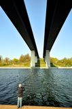 Fishing under bridge Royalty Free Stock Photo