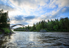 Fishing under the bridge. Fly fishing wast water part of lake exit, Sweden Stock Image