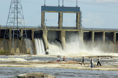 Fishing under the dam. A large power dam with a group of fishermen Stock Photos
