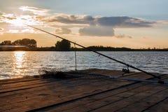 Fishing utensils on a wooden platform Royalty Free Stock Photo