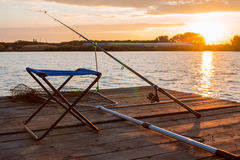 Fishing utensils on a wooden platform Royalty Free Stock Images